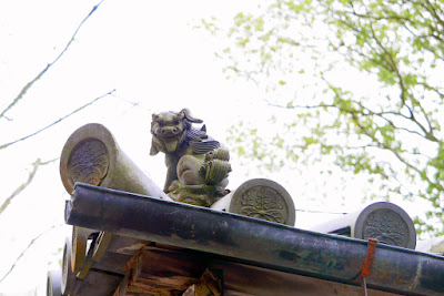 The Guardian Lion at the gate roofs of Kinkakuji (Golden Pavilion) in Kyoto have a variety of great poses that are a bit humorous