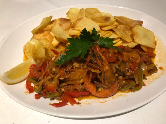 Bacalhau a Barros : Fried salted cod fish garnished with peppers , onions and king prawn