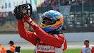 Fernando Alonso points at Ferrari Horse on his steeringwheel