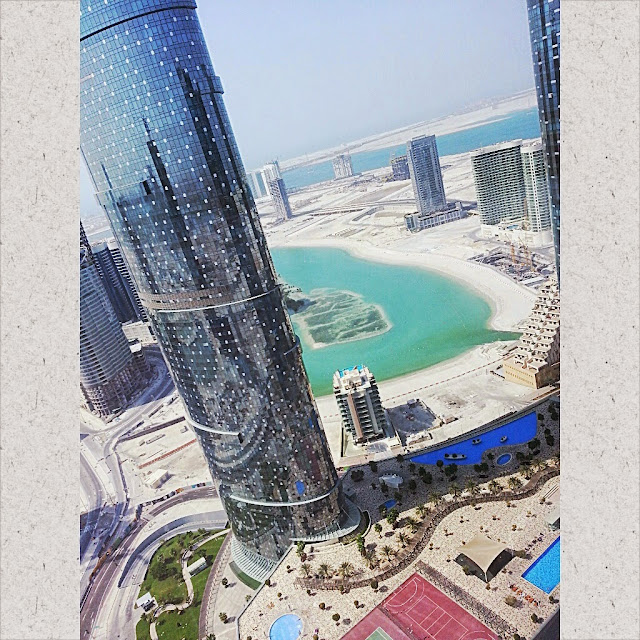 Travel Journal to Abu Dhabi UAE by ServicefromHeart Reem Island Sun Sky sea Gate Towers