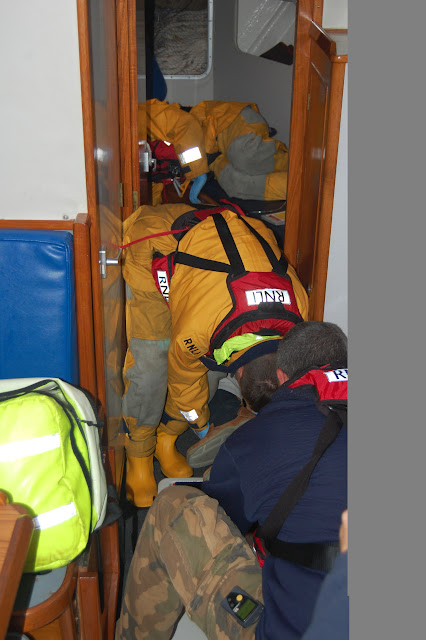 10 June 2012 - Lifeboat crew carefully moving a casualty with a head and spinal injury from the very tight forward cabin during a medical training exercise