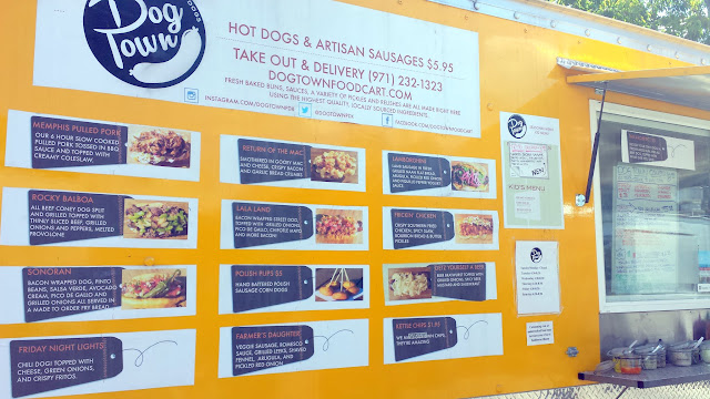 Dog Town, located at Tidbit Food cart at SE 28th and Division offers an impressive heavily topped hot dog menu selection in Portland