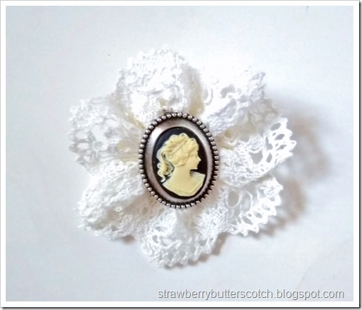 Close up of the cameo lace rosette broach.