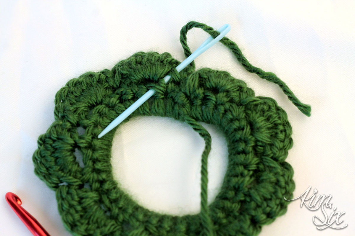 Weaving in crochet ends on wreath