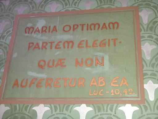 """A legenda em latim significa """"Maria escolheu a boa parte, que lhe não será tirada."""""""