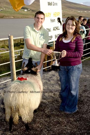 Gemma Patten presents the Patten's Bar Cup to Stephen Grealis, Currane for Best Ram Lamb (Confined) at the 21st Achill Sheep Show (Taispeántas Caorach Acla 2007) at Pattens Bar, Derreens Achill. Photo: © Michael Donnelly