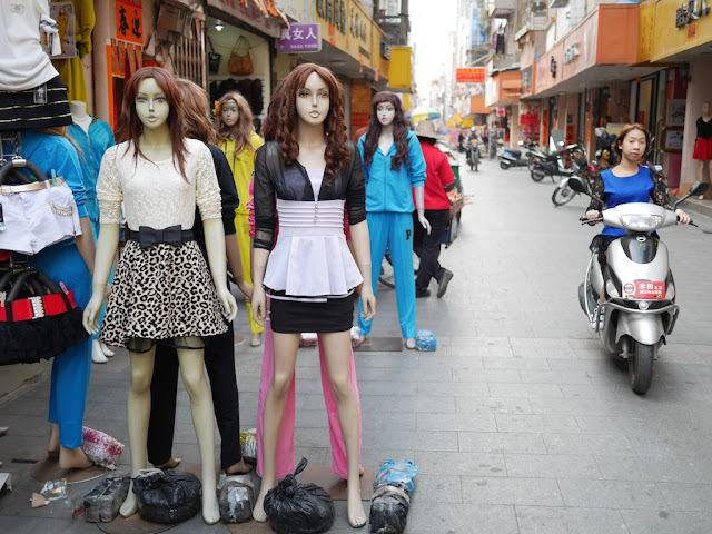 mannequins and young woman on a motorbike in Yangjiang, China