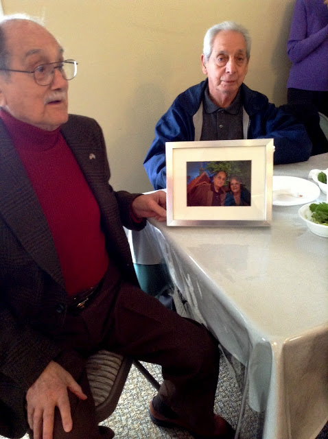 The gift was a framed photo of George and Helen with the church as the background.