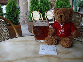 The Bear having a beer at a sidewalk cafe. Looks like his beer and our wine cost about 19 euros.