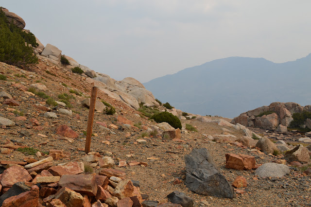 top of the pass marked by a post