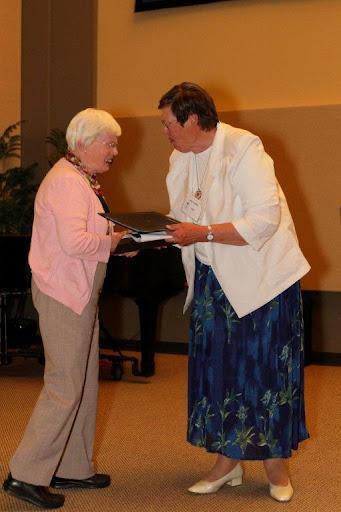 Helen Backhouse receiving award from Past President Kay Clarke