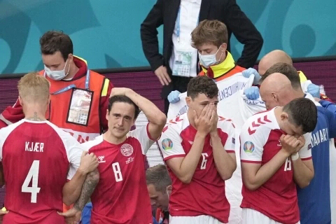 Scary moment Denmark and Inter Milan player Christian Eriksen collapses during game, prompting resuscitation attempts