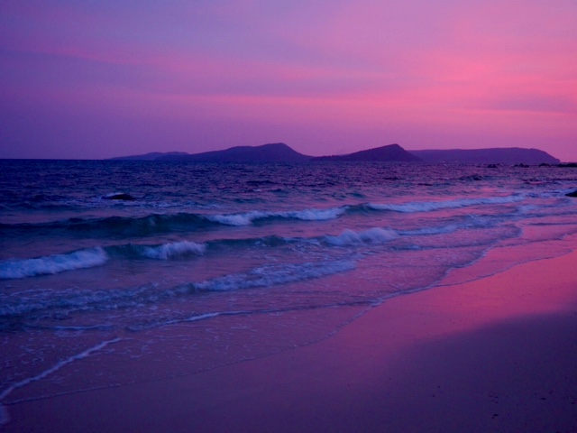 Pink and purple lighting on the ocean at sunset | Nature Beach, Koh Rong, Cambodia