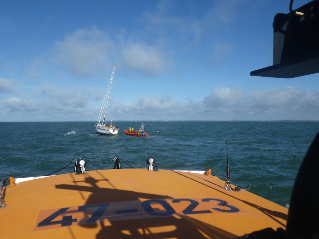 Poole ALB coming alongside the ILB and a yacht with engine and steering failure in Poole Bay on 11 May 2013. Photo: RNLI/Poole Neil Ceconi