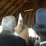 Wedding at the Kgotla, the father of the groom waves a white flag signifying that he agrees with what the bride's parents have said