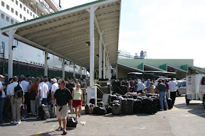 Luggage and passengers waiting to board the Queen Mary 2