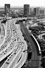 """Photo: Almost Rush Hour; Am I Home Yet? You know it's almost rush hour when the cars start to stack up along the Gardiner and the """"Squinties"""" begin their hellish commute back to their western suburbs. Is this the life we long for?  Tags: #toronto #rushhour #traffic #rooftopping #urbex #urbanexploration #blackandwhite"""