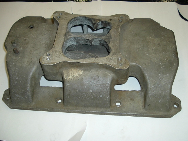Max's single 4 barrel manifold, it was an open plenum type with a divider in the center.