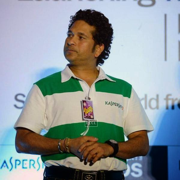 Sachin Tendulkar gets clicked on the stage during Kaspersky Kids awareness programme, held at Ryan International School, on July 23, 2014. (Pic: Viral Bhayani)