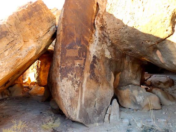 Sheep petroglyphs and boulder shelters