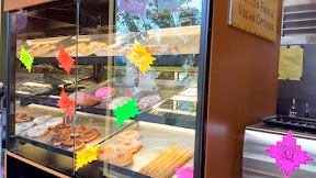 At Portland Mercado, inside the Cafe Revolucion Coffee Shop are some amazing looking dessert pastries such as 3 leches cake and flan in the cases or here in the pastry cabinet Conchas and Nino Envuelta and more