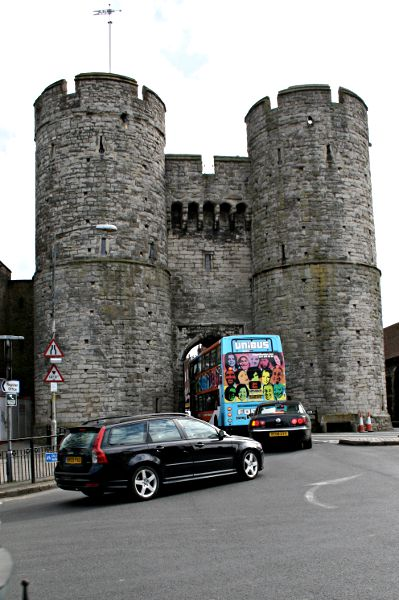 traffic passing through medieval stone gateway