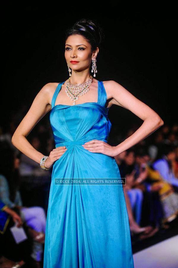 A model displays a creation by Mahabir & KIK Jewells on Day 3 of India International Jewellery Week (IIJW), 2014, held at Grand Hyatt, in Mumbai.