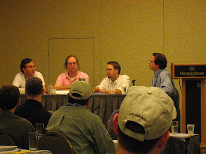 Photo: Elliotte Rusty Harold and Jason Hunter during a panel. In the ROME wiki we quote Elliotte about API design, and we use Jason's JDOM. I was very happy to see them in real life. The panel also had Eric Van Der Vlist and Simon St Laurent.