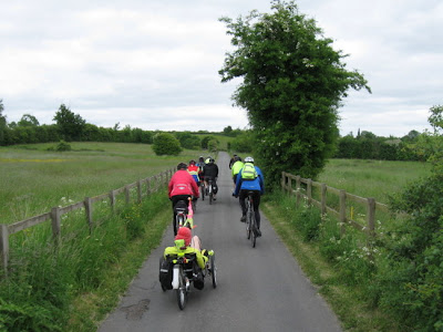 Cycling along fenced lane