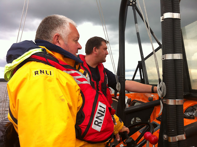Our illustrious leaders en route to a catamaran that had gone aground at the entrance to the Wareham Channel - 19 July 2012. Photo: RNLI/Poole Dave Riley