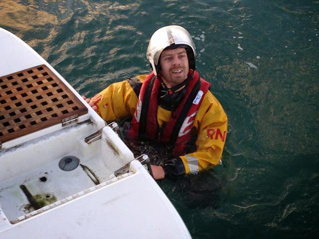 A crew member checks the propellor - 30 December 2014.  Photo credit: Alex Evans