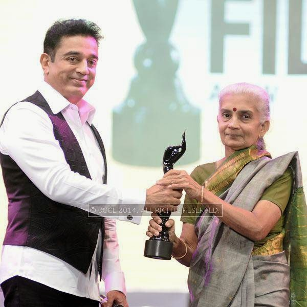 Kamal Haasan presents the Lifetime Achievement Award to Balu Mahendra, which is received by his wife Akhila to a standing ovation by the crowd during the 61st Idea Filmfare Awards South, held in Chennai, on July 12, 2014.