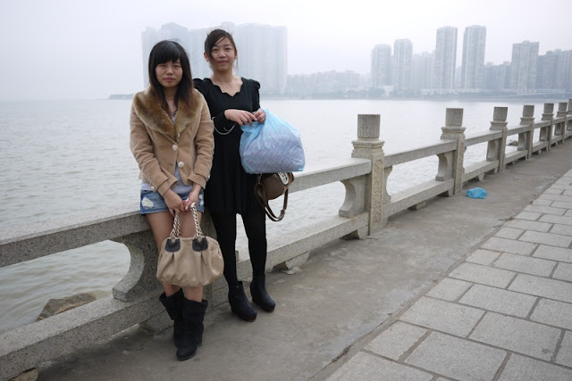 two young ladies in Zhuhai with sea and Macau in the background