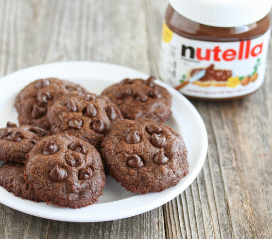 photo of cookies on a plate with a jar of Nutella in the background