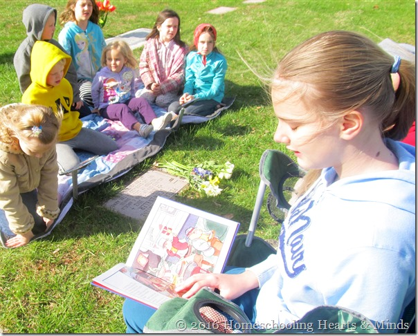 Mary reading during graveside memorial at Homeschooling Hearts & Minds