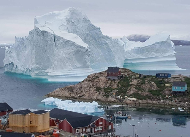 For a week in July 2018, an iceberg as tall as the Statue of Liberty filled the villagers of Innaarsuit, Greenland, with existential dread. Photo: Magnus Kristensen / Ritzau Scanpix / Reuters