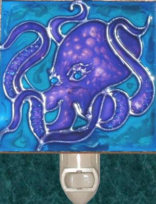 Purplish Blue Mottled Octopus in wavy blue ocean