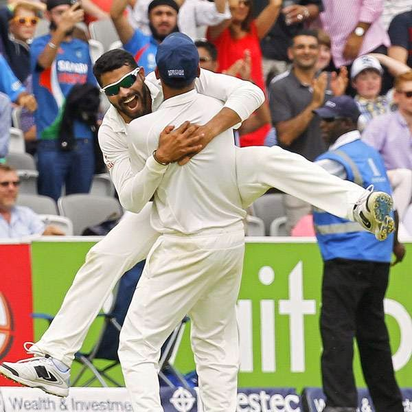 India's Ravindra Jadeja (Facing) celebrates taking the final wicket of England's James Anderson to give India victory by 95 runs on the fifth day of the second cricket Test match between England and India at Lord's cricket ground in London on July 21, 2014.