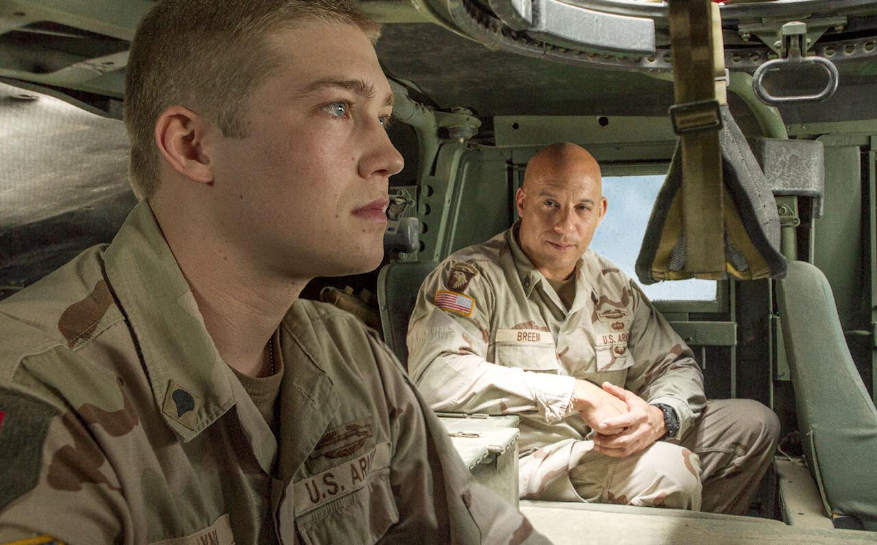 Billy Lynn ( Joe Alwyn) talks to Shroom (Vin Diesel) in TriStar Pictures' BILLY LYNN'S LONG HALFTIME WALK. (Photo by Mary Cybulski / courtesy of Sony Pictures).