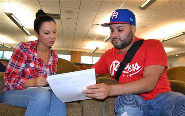 Maria Teresa Rosado (Left) and Luis Flores (Right) recently arrived from Puerto Rico. They sought assistance at the hurricane relief center in Miami International Airport on 29 November 2017. Photo: Carmen Sesin / NBC News