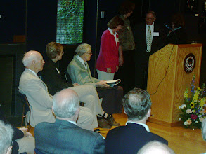 Photo: Dr. Bartels receiving the memory book