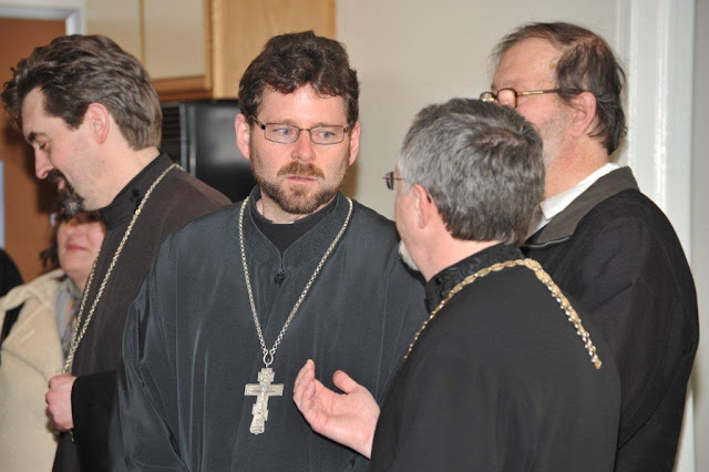 Fr. John talks with Fr. Martin.