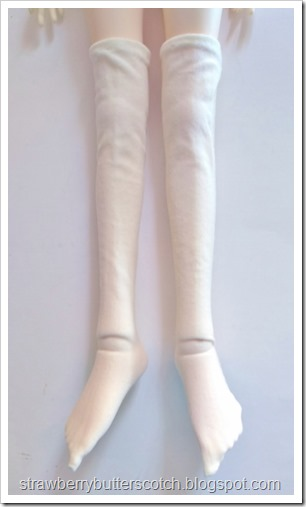 Doll sized thigh high socks made from old tights.