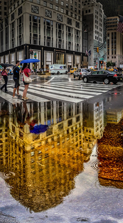 New York City reflection shot on a rainy day by +Christopher Wieser  While walking towards one of the...