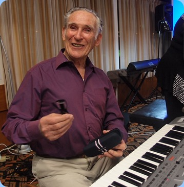 Roy Steen preparing to play his Korg Pa80. Photo courtesy of Dennis Lyons.