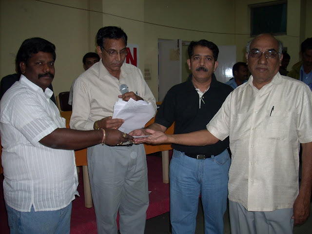 6. Dr Srinivas and YV Rao receiving a prize from S Ramana Rao EC member