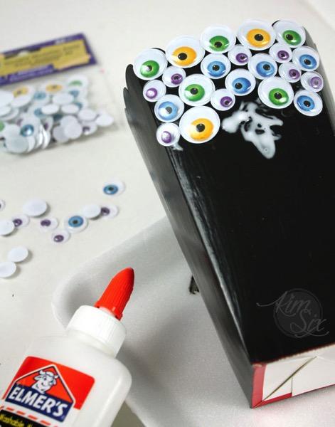 Gluing eyeballs to popcorn box