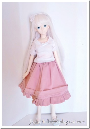 Before the petticoat, Hikaru is wearing a full pink skirt that only flares out a little.