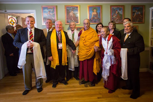 Front row (from left): State Representative Sean Garballey, Medford Mayor Michael McGlynn,  His Holiness the Dalai Lama,  Geshe Tenley and State Representative Paul Donato; back row (from left): friend of mayor, John McGlynn, Mayor McGlynn's daughter and sister, and State Representative Carl Sciortino; Kurukulla Center, October 2012. Photo by Cherrie Corey.
