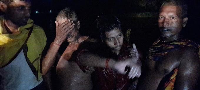 धनार्जय नदी के बीच में घंटों फ़ंसा रहा युवक, प्रशासन और स्थानीय लोग जुटे निकालने में